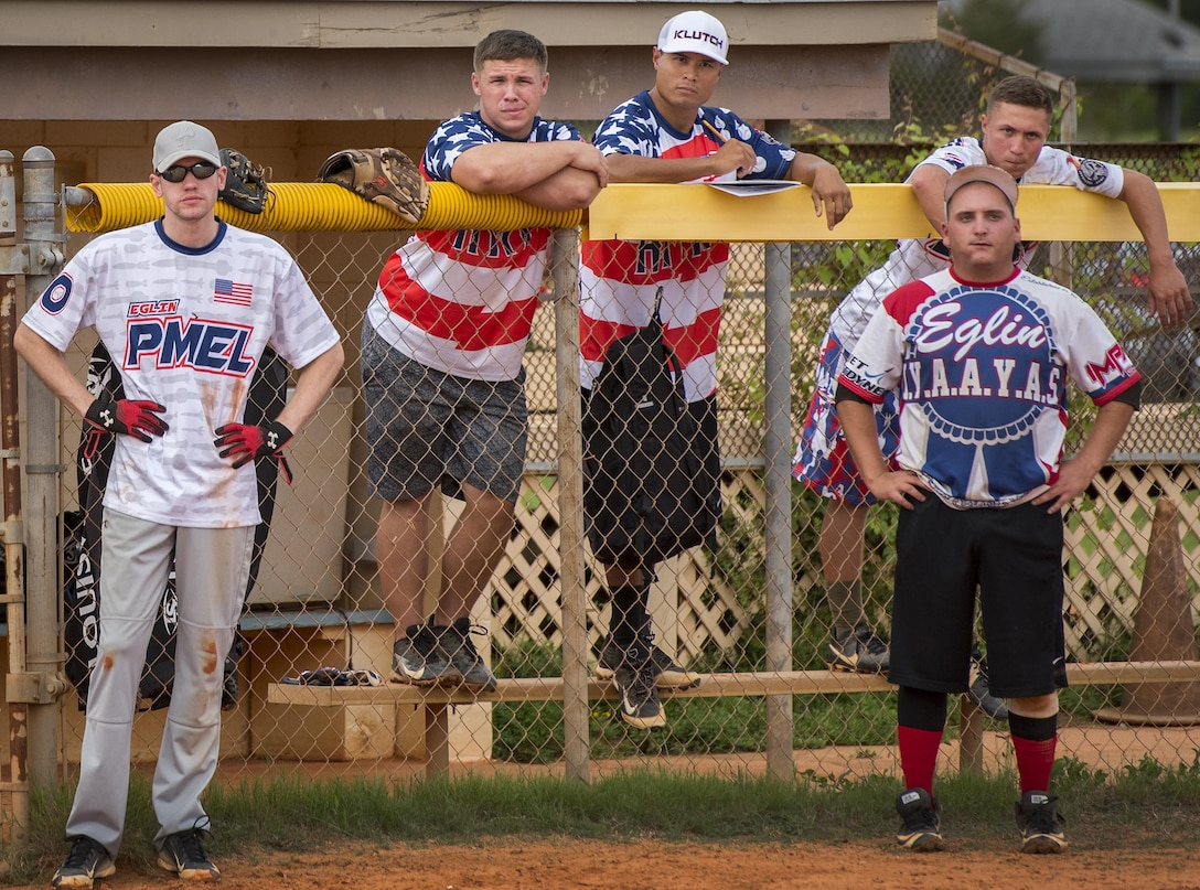 Clad in red white and blue, 96th Maintenance Squadron team members watch the intramural softball game against the 359th Training Squadron team July 17 at Eglin Air Force Base, Fla.  The league-leading Maintainers pounded the Training Squadron 10-5 to improve to 9-1 on the season.  (U.S. Air Force photo/Samuel King Jr.)