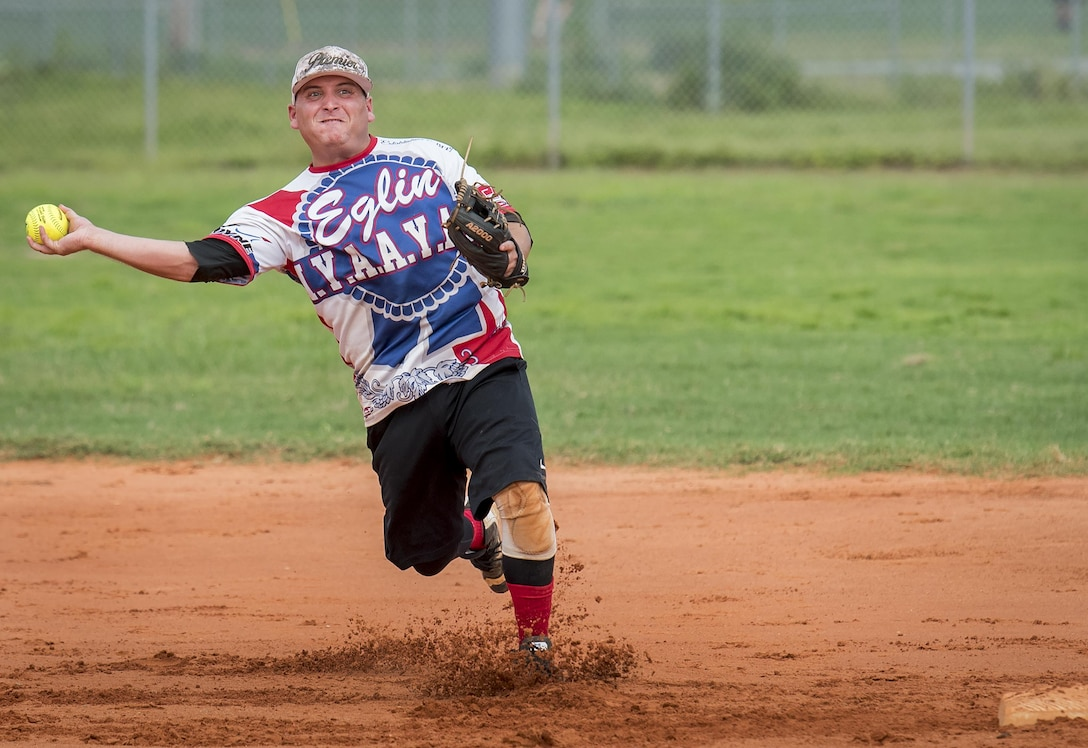 Tyler Leemon, 96th Maintenance Squadron softball team shortstop, slings a throw to first base during an intramural game against the 359th Training Squadron team July 17 at Eglin Air Force Base, Fla.  The league-leading Maintainers pounded the training squadron 10-5 to improve to 9-1 on the season.  (U.S. Air Force photo/Samuel King Jr.)