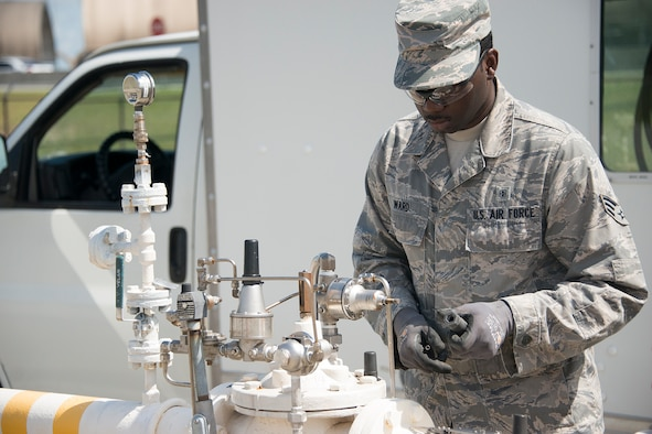 Senior Airman Darnell Ward, 919th Special Operations Civil Engineer Squadron, calibrates the automatic control valve on the fuel line at Eglin Air Force Base, Fla.,July 8, 2017. The fuel line controls the pressure and rate at which fuel is transferred from the storage tanks to vehicles which service aircraft arriving and departing the base. The tests ensure there is no damage to aircraft or refueling vehicles due to tanks being over pressurized. (Air Force photo/Lt. Col. James R. Wilson)