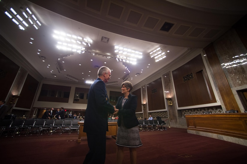 U.S. Air Force Gen. Paul J. Selva, Vice Chairman of the Joint Chiefs of Staff, greets Sen. Joni Ernst before testifying during a Senate Armed Services Committee hearing on Capitol Hill in Washington, July 18, 2017. The hearing was held to consider Gen. Selva's reappointment to the grade of general and as the Vice Chairman. (DoD Photo by U.S. Army Sgt. James K. McCann)