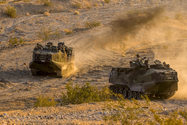 Marines drive amphibious assault vehicles across the desert at Marine Air Ground Combat Center Twentynine Palms, Calif., July 15, 2017. The Marines, assigned to the 2nd Battalion, 7th Marine Regiment, were preparing for a deployment. Marine Corps photo by Cpl. Justin Huffty