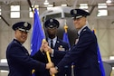 Lt. Gen. Giovanni Tuck, 18th Air Force commander, passes the 22nd Air Refueling Wing guidon to Col. Joshua Olson, the incoming 22nd ARW commander, during the change of command ceremony, July 18, 2017, at McConnell Air Force Base, Kan. Olson took command of the 22nd ARW after a year-long deployment to the Middle East. (U.S. Air Force photo/Staff Sgt. Trevor Rhynes)