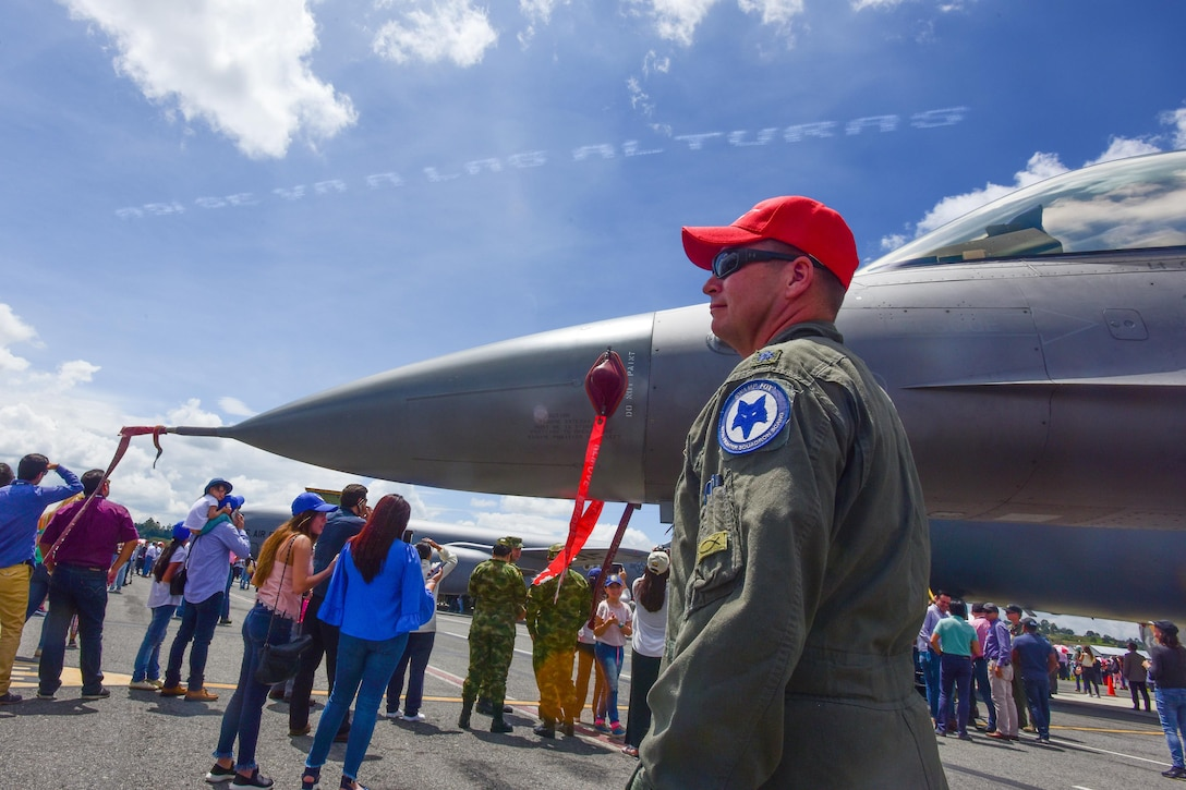 U.S. Air Force Lt. Col. Andrew Thorne, a fighter pilot assigned to the 157th Fighter Squadron, stands next to a U.S. Air Force F-16 Fighting Falcon assigned to the South Carolina Air National Guard's 169th Fighter Wing while at José María Córdova International Airport duringthe Colombian Air Force's Feria Aeronautica Internaccional – Colombia in Rionegro, Colombia, July 14, 2017. The United States Air Force is participating in the four-day air show with two South Carolina Air National Guard F-16s as static displays, plus static displays of a KC-135, KC-10, along with an F-16 aerial demonstration by the Air Combat Command's Viper East Demo Team. United States military participation in the air show provides an opportunity to strengthen our military-to-military relationships with regional partners and provides the opportunity to meet with our Colombian air force counterparts and facilitate interoperability, which can be exercised in future cooperation events such as exercises and training. (U.S. Air National Guard photo by Senior Airman Megan Floyd)