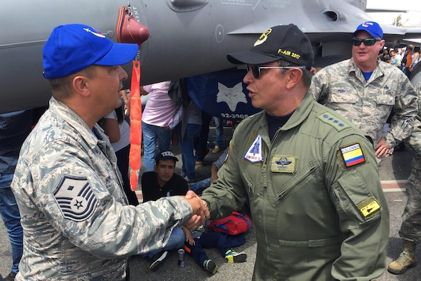 Colombian Air Force Gen. Carlos Bueno (right) speaks to Master Sgt. Jeff Hopper, during the Force's Feria Aeronautica Internaccional – Colombia in Rionegro. Bueno thanked Airmen of the South Carolina Air National Guard's 169th Fighter Wing for their support during the air show, July 16, 2017. The United States Air Force participated in the four-day air and trade show providing static displays of various aircraft to include the F-16, KC-10 and KC-135. During the air show the Air Combat Team's Viper East Demo Team performed daily and a B-52 from US Strategic Command performed a flyover. The United States military participation in the air show provides an opportunity to strengthen our military-to-military relationships with regional partners and provides the opportunity to meet with Colombian air force counterparts. (U.S. Air National Guard photo by Capt. Stephen D. Hudson).
