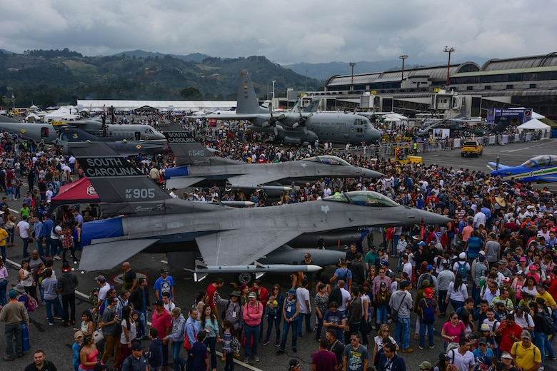 Guests watch the aerial demonstrations at José María Córdova International Airport during Feria Aeronautica Internacional—Colombia 2017 in Rionegro, Colombia, July 15, 2017. The United States Air Force is participating in the four-day air show with two South Carolina Air National Guard F-16s as static displays, plus many other displays.