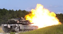 An M1A1 Abrams battle tank fires a round at a simulated target during a combined arms range for Iron Wolf 17 at Camp Lejeune, N.C., July 14, 2017. Iron Wolf 17 is a multi-unit exercise designed to simulate battlefield conditions Marines may face while deployed. The tanks are from 2nd Tank Battalion, 2nd Marine Division. (United States Marine Corps photo by Cpl. Jon Sosner)