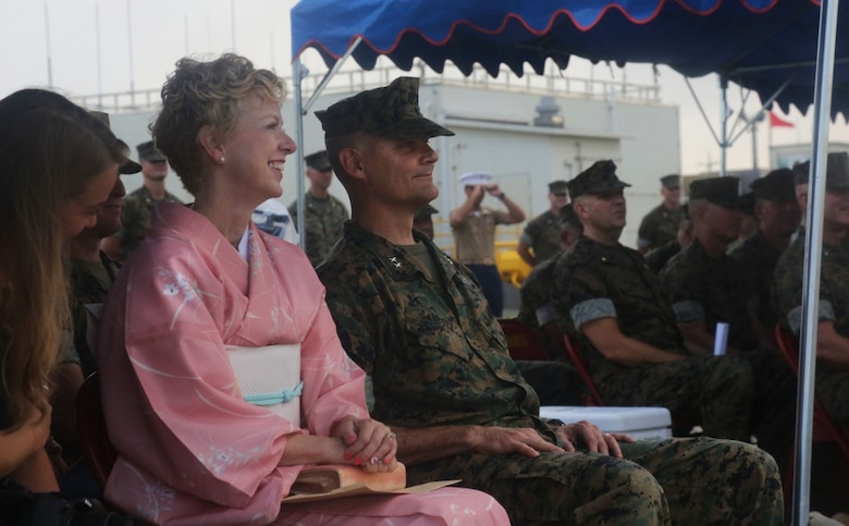 U.S. Marine Corps Maj. Gen. Russell A. Sanborn and his wife Linda Sanborn listen as Lt. Gen. Lawrence D. Nicholson speaks to the audience during a change of command ceremony at Marine Corps Air Station Futenma, Okinawa, Japan, June 29, 2017. Sanborn is the outgoing 1st Marine Aircraft Wing commanding general and Nicholson is the III Marine Expeditionary Force commanding general. Sanborn relinquished command to Brig. Gen. Thomas D. Weidley and will assume command of Marine Forces Europe and Africa. (U.S. Marine Corps photo by Lance Cpl. Isabella Ortega)