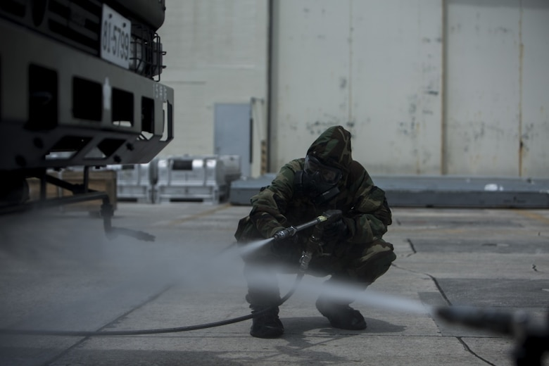 U.S. Marine Lance Cpl. Enrique Puentes Jr. decontaminates a Japanese Decontamination Truck during a simulated joint study with the Japanese Ground Self-Defense Force at Marine Corps Air Station Futenma, Okinawa, Japan, oJuly 13, 2017. Puentes, a native of Tampa, Florida, is a CBRN defense specialist with Marine Wing Headquarters Squadron 1. (U.S. Marine Corps photo by Cpl. Kelsey Dornfeld).