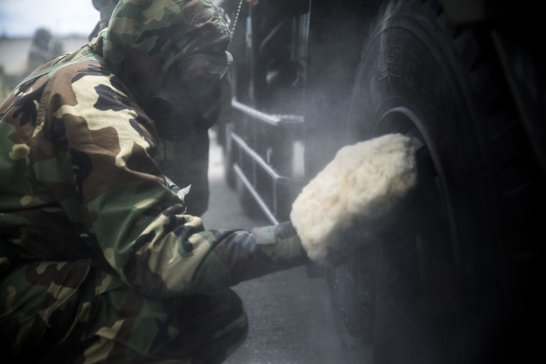 U.S. Marine Pfc. Matthew Worth scrubs a Japanese Decontamination Truck during a simulated joint study at Marine Corps Air Station Futenma on July 13, 2017. The event tested the Marines' and Japanese Ground Self-Defense Force chemical, biological, radiological and nuclear response capabilities to a chemical attack on a flight line. The simulated mission allowed the Marines and the JGSDF to react as if the air strip was under a CBRN attack and share their capabilities with each other. Worth, a native of Pemberton, New Jersey, is a CBRN defense specialist with Marine Wing Headquarters Squadron 1 (U.S. Marine Corps photo by Cpl. Kelsey Dornfeld).