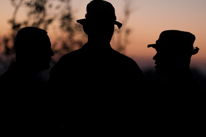 Marines with Weapons Company, Battalion Landing Team, 3rd Battalion, 5th Marines, spend a few minutes  of pause as the sun sets at the end of day five of Exercise Talisman Saber 17 on Townshend Island, Shoalwater Bay Training Area, Queensland, Australia, July 17, 2017. BLT 3/5, the Ground Combat Element for the 31st Marine Expeditionary Unit, is exploring state-of-the-art concepts and technologies as the dedicated force for Sea Dragon 2025, a Marine Corps initiative to prepare for future battles. The 31st MEU is taking part in Talisman Saber 17 while deployed on a regularly-scheduled patrol of the Indo-Asia-Pacific region. Talisman Saber is a biennial exercise designed to improve the interoperability between Australian and U.S. forces.