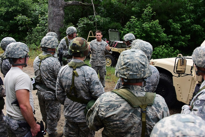 Master Sgt. Aaron Weber, 166th Civil Engineer Squadron, Delaware Air National Guard coaches airman on convoy operations during convoy operations training at Redden State Forest, Georgetown, De., 15 July 2017. (U.S. Air National Guard photo by SSgt. Andrew Horgan/released)