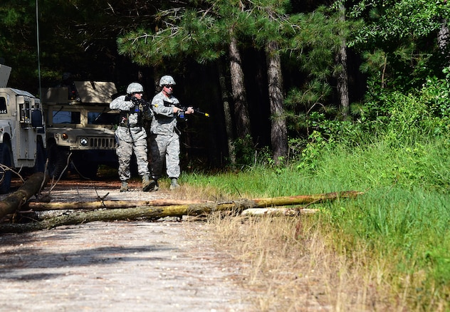 From Left, Senior Airman Robert Bickel and Tech. Sgt. Stephen Sapp, 166th Civil Engineer Squadron, Delaware Air National Guard, patrol for unfriendly forces when their convoy is road blocked during convoy operations training at Redden State Forest, Georgetown, De., 15 July 2017. (U.S. Air National Guard photo by SSgt. Andrew Horgan/released)