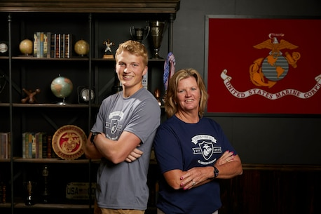 Colin Williams (left), a Naples Florida native, poses with his mentor during the Semper Fidelis All-American Program and Battles Won Academy in Washington, D.C., July 13, 2017. Students from across the nation were selected to attend this academy where they participated in a variety of team building and leadership exercises. Williams is a student from Naples High School, Naples, Florida. (Courtesy photo)