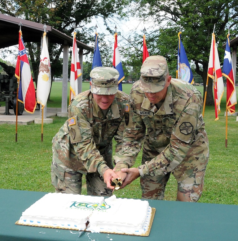 "Maj. Gen. Troy D. Kok, commanding general for the U.S. Army Reserve's 99th Regional Support Command, and Command Sgt. Maj. Patrick McKie, Army Support Activity, Fort Dix command sergeant major, cut the cake July 18 during the Dix Centennial celebration at Joint Base McGuire-Dix-Lakehurst, New Jersey.  Camp Dix provided key support to the Army and the nation from its inception in 1917 until its re-designation as ""Fort Dix"" in 1939.  On Oct. 1, 2009, Fort Dix transformed into the United States Army Support Activity, Fort Dix and became part of Joint Base McGuire-Dix-Lakehurst.  More than 42,000 active-duty and reserve-component service members, civilian employees and family members work and reside on the base."