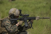 A U.S. Marine with 1st Battalion, 6th Marine Regiment, 2nd Marine Division (2d MARDIV), aims down range utilizing his Sea Dragon 2025 weapon systems and gear during a live-fire range at Range G-6, Camp Lejeune, N.C., July 12, 2017. The Sea Dragon 2025 equipment showcased new capabilities for Marines to use in future exercises and operations. (U.S. Marine Corps photo by Lance Cpl. Justin X. Toledo)