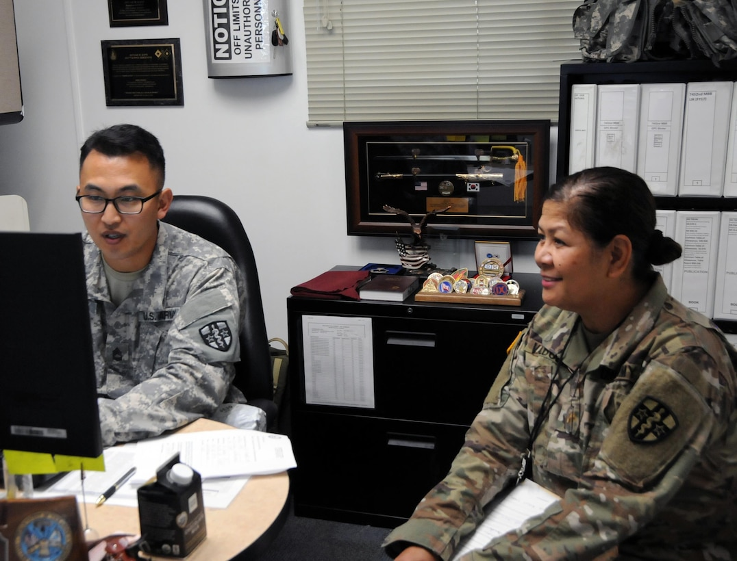Sgt. 1st Class Jae Kang, the unit supply specialist for the 7452nd Medical Backfill Battalion, helps Maj. Priscilla Valbuena, a critical care nurse, who has been identified to prepare for a Professional Filler System (PROFIS) mission.  Soldiers mobilized to support this mission will backfill Medical Command's active duty slots at medical centers and clinics across their health care organization.  Army Medical Department Professional Management Command (APMC) hosted the Soldier Readiness Processing (SRP) level 2 from 7-9 Jul., processing approximately 100 U.S. Army Reserve Soldiers from the 7452nd MBB during the 3-day event. The objective of the process is for Soldiers to be administratively, financially, legally, spiritually, logistically and medically ready to be mobilized after attending an SRP.
