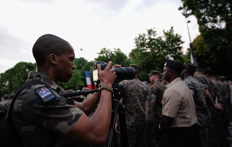 An Armée de Terre photographer takes photos of U.S. military members during a Bastille Day military parade rehearsal at the Avenue des Champs-Élysées, France, July 10, 2017. More than 200 U.S. service members led the Bastille Day military parade on July 14, 2017, to commemorate the 100 year anniversary of the U.S. entering World War I and joining the allied forces. (U.S. Air Force photo by Airman 1st Class Savannah L. Waters)