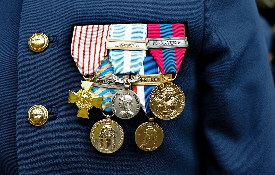 A Bastille Day military parade participant's medals are displayed on their uniform at Camp de Satory, France, July 12, 2017. U.S. and Armée de Terre military members marched in the Bastille Day military parade at the Avenue des Champs-Élysées, France, on July 14, 2017, to celebrate the French Republic's National Day. (U.S. Air Force photo by Airman 1st Class Savannah L. Waters)