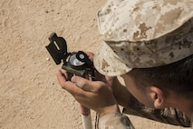 U.S. Marine Corps Lance Cpl. Andrew A. Ward, squad leader with 1st Battalion 1st Marine Regiment, Marine Air-Ground Task Force-8 (MAGTF) establishes the mounting azimuth for mortar familiarization training during Integrated Training Exercise (ITX) 5-17 at Marine Corps Air Ground Combat Center, Twentynine Palms, Calif., July 18, 2017. The purpose of ITX is to create a challenging, realistic training environment that produces combat-ready forces capable of operating as an integrated MAGTF. (U.S. Marine Corps Photo by Cpl. Justin M. Smith)