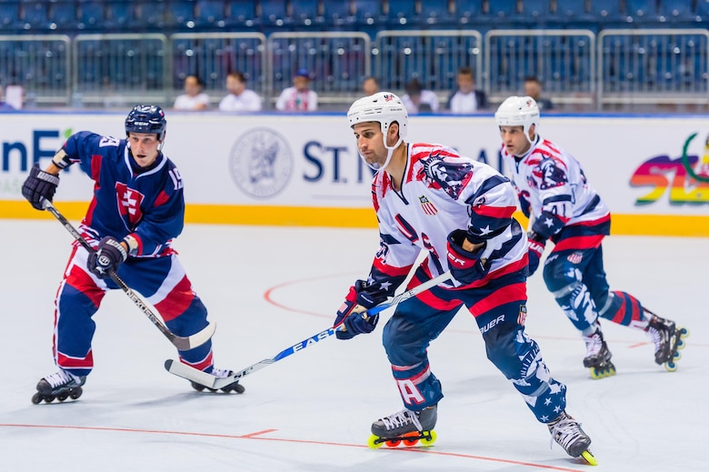 Capt. Derrick Burnett, National Reconnaissance Office, chief of mission operations, defends against Team Finland's offense during the world championship game at the Ondrej Nepala Arena, Bratislava, Slovakia, July 1, 2017.  Burnett was the oldest member of the team, but played defense for all six games of the tournament. (Photo by Jozef Kaffka/StarLine photography)