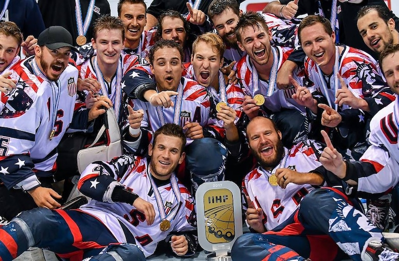 Team USA, 2017 International Ice Hockey Federation In-line Hockey World Championship winners, celebrate with their trophy after their gold-medal victory against Finland at the Ondrej Nepala Arena, Bratislava, Slovakia, July 1, 2017.  Capt. Derrick Burnett, National Reconnaissance Office, chief of mission operations, played his third year as a defenseman for Team USA, this being the first year he made it past the semifinal game. (Photo by Jan Sukup)
