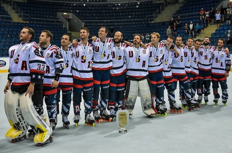 Team USA, 2017 International Ice Hockey Federation In-line Hockey World Championship winners, stand in line and listen as their national anthem is played after their gold-medal victory against Finland at the Ondrej Nepala Arena, Bratislava, Slovakia, July 1, 2017.  Capt. Derrick Burnett, National Reconnaissance Office, chief of mission operations, played as a defenseman for the team during the gold-medal game. (Photo by Jan Sukup)