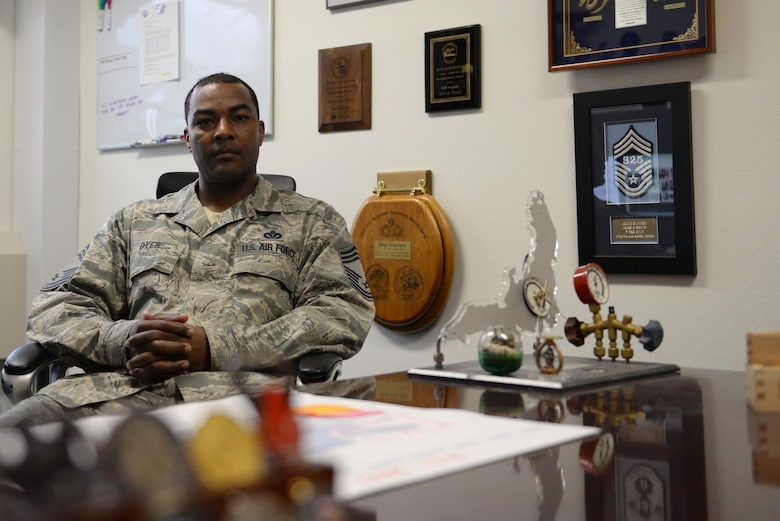U.S. Air Force Chief Master Sgt. Alvin Dyer, the 354th Civil Engineer Squadron superintendent, poses for a photo in his office July 13, 2017, at Eielson Air Force Base, Alaska. Dyer didn't always want to become a chief master sergeant, but he said life had different plans for him. (U.S. Air Force photo by Senior Airman Cassie Whitman)