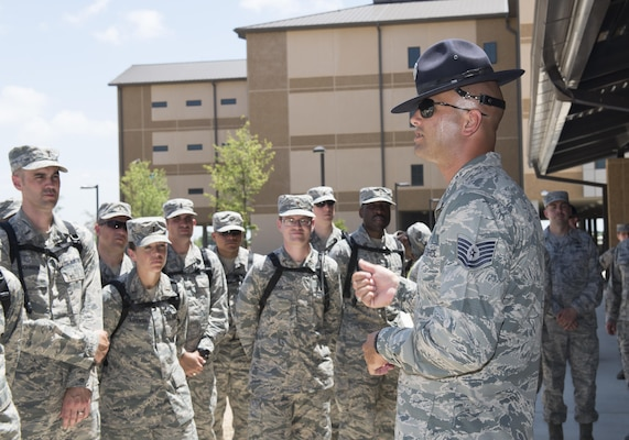 Tech. Sgt. Paul Couch, 323rd Training Squadron military training instructor, provides a tour to chaplain candidates of an Airman Training Complex at Joint Base San Antonio-Lackland, Texas, July 5, 2017. The tour was part of the Chaplain Candidate Intensive Internship. (U.S. Air Force photo by Senior Airman Krystal Wright)