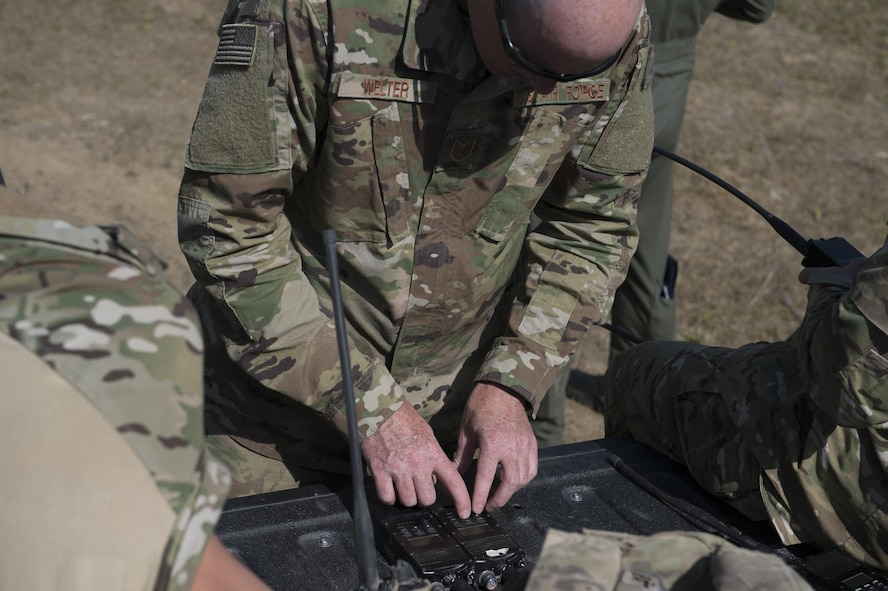 U.S. Air Force Tech. Sgt. John Welter, the 5th Air Support Operations Squadron (ASOS) bravo flight, flight chief, works on a radio during Distant Frontier June 29, 2017, on the Joint Pacific Alaska Range Complex, Delta Junction, Alaska. During Distant Frontier, the 5th ASOS provided ground control for participants. (U.S. Air Force photo by Airman 1st Class Isaac Johnson)