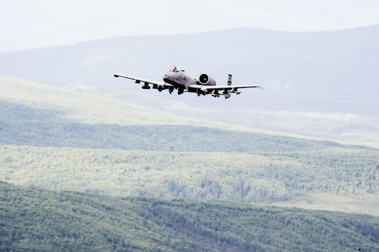 A U.S. Air Force A-10 Thunderbolt aircraft assigned to the 25th Fighter Squadron out of Osan Air Base, South Korea, performs a maneuver in the Joint Pacific Alaska Range Complex June 29, 2017, in Delta Junction, Alaska. The A-10 Thunderbolt II is an accurate and survivable weapons-delivery platform. (U.S. Air Force photo by Airman 1st Class Isaac Johnson)