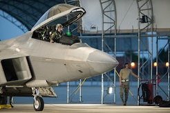 A 1st Fighter Wing F-22 pilot and maintenance Airman prepare to launch a jet for take off at Joint Base Langley-Eustis, Va., July 11, 2017. The wing conducted night flying training missions to keep pilots current on skills needed to operate in the dark. (U.S. Air Force Photo/Master Sgt. Benjamin Wilson)