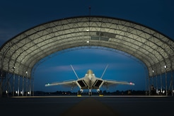A U.S. Air Force F-22 Raptor pilot, assigned to the1st Fighter Wing, checks effective operation of flight control surfaces, during night operations at Joint Base Langley-Eustis, Va., July 11, 2017. To help increase effectiveness during night operations, the 1st FW has installed new sun shades that have solar powered lights, allowing night time maintenance and flying.  (U.S. Air Force photo/Staff Sgt. Carlin Leslie)