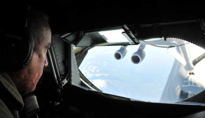 Tech. Sgt. Richard Costaflis, a 940th Air Refueling Wing boom operator from Beale Air Force Base, California, refuels a C-5 Galaxy from Travis AFB, California, over the Sierra Nevada Mountains. (Airman Tristan D. Viglianco)
