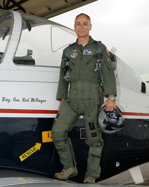 "Brig. Gen. Udo ""Karl"" McGregor is scheduled to retire Sept. 1 after 41 years of military service. Here, he poses in front of his aircraft at Columbus Air Force Base, Mississippi, in June 2013."