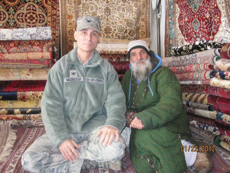 McGregor, at the time a colonel, poses with Haji, an Afghan run merchant, in Kabul, Afghanistan, in January 2012. The two became friends during McGregor's time there.