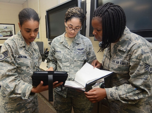 (Left to right) Staff Sgt. Chantel Benjamin, Tech. Sgt. Susan Robinson and Staff Sgt. Stephanie Lee of the 700th Airlift Squadron get hands-on experience on the Mobile Mission Kit during its test phase at Dobbins Air Reserve Base, Georgia. (Don Peek)