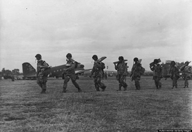 A line of American paratroopers with full equipment march to their Douglas C 47 transports ready for the D-Day invasion on June 6, 1944. (Hulton Archive/Getty Images)