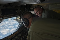 Senior Master Sgt. Aaron Achenbach, alongside Chief Master Sgt. Michael Zimmerman, 328th Air Refueling Squadron, perform in-flight training on a KC-135 Stratotanker, July 18, 2017, Niagara Falls Air Reserve Station, N.Y. Air crew personnel performed various procedures to further familiarize themselves with the new aircraft. The 914th officially became an Air Refueling Wing in June 2017, acquiring a new airframe and mission. (U.S. Air Force photo by Tech. Sgt. Steph Sawyer)
