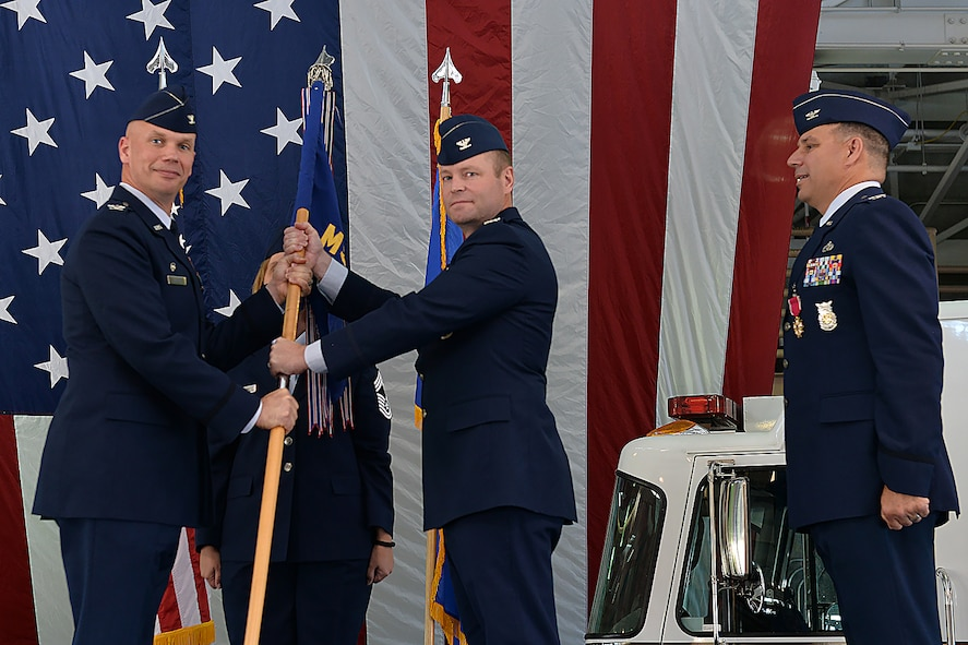 55th Wing Commander Col. Michael Manion, left, presents the 55th Mission Support Group guidon to Col. David Norton, center, as he accepts command of the 55th MSG at Offutt Air Force Base, Nebraska, July 14, 2017. Outgoing 55th MSG Commander Col. Matthew Joganich, right, surrendered command of the 55th MSG, which is responsible for five squadrons encompassing 1,600 individuals who support Air Combat Command's largest wing and over 50 tenant units.