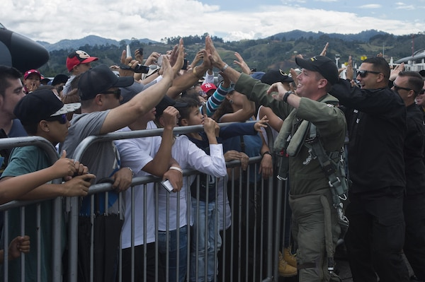 Members of the Air Combat Command F-16 Viper Demonstration Team greet attendees of the F-AIR COLOMBIA 2017 in Rionegro, Colombia, Juy 15, 2017. The demonstration team, along with Airmen from other units across the country, visited Colombia to showcase the capabilities of the U.S. Air Force while fostering a positive relationship between the U.S. and Colombia. (U.S. Air Force photo by Staff Sgt. Zade Vadnais)