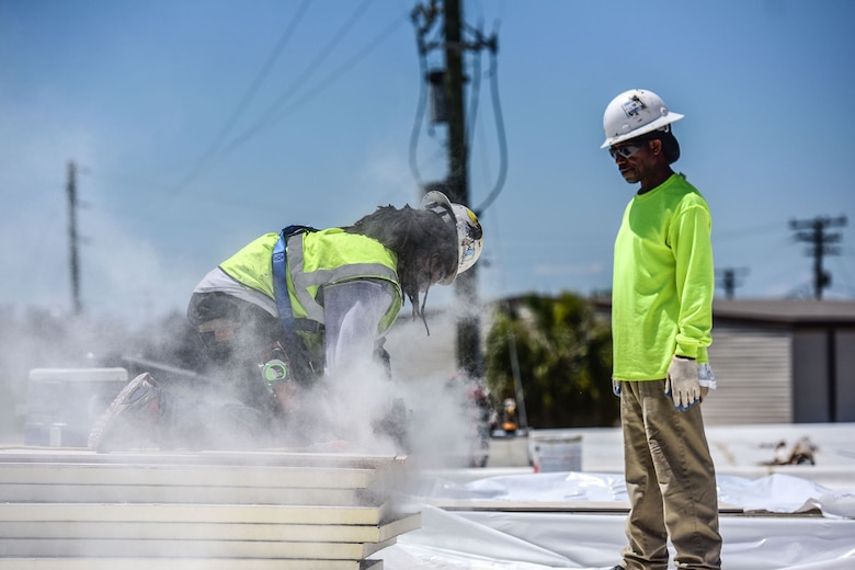 Jamel Moody, a civilian contractor, cuts sheet rock on the roof of the Base Operations building during a renovation project at McEntire Joint National Guard Base, S.C., June 8, 2017. Select buildings and runway sections are undergoing renovations designed and contracted by the 169th Civil Engineer Squadron which will aid training missions of Swamp Fox Airmen. (U.S. Air National Guard photo by Senior Airman Megan Floyd)
