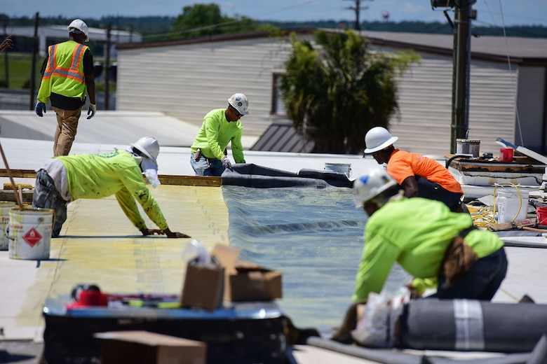 Civilian contractors work on renovation projects at various locations around McEntire Joint National Guard Base, S.C., June 8, 2017. Select buildings and runway sections are undergoing renovations designed and contracted by the 169th Civil Engineer Squadron which will aid training missions of Swamp Fox Airmen. (U.S. Air National Guard photo by Senior Airman Megan Floyd)