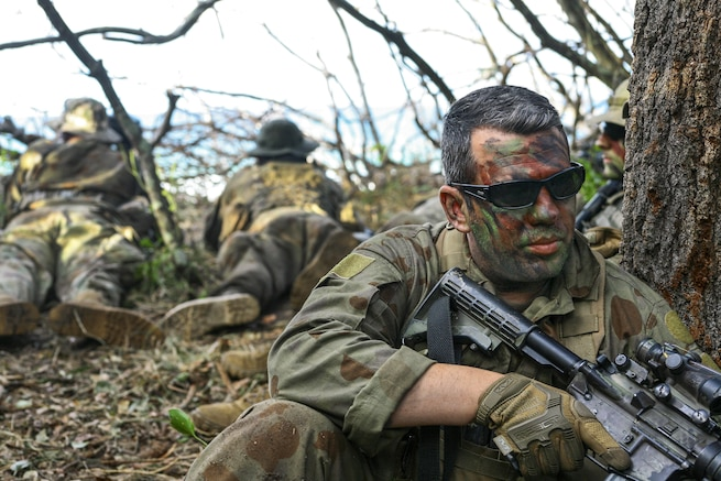 Army Sgt. Anthony Coppola guards an observation post at Shoalwater Bay, Queensland, Australia, July 14, 2017, during exercise Talisman Saber with Australian and New Zealand forces. Coppola is an assistant team leader assigned to the New York Army National Guard's 2nd Squadron, 101st Cavalry Regiment. He wore a mix of Australian and American uniform items because of the unit's role as an opposing force. Army National Guard photo by Sgt. Alexander Rector
