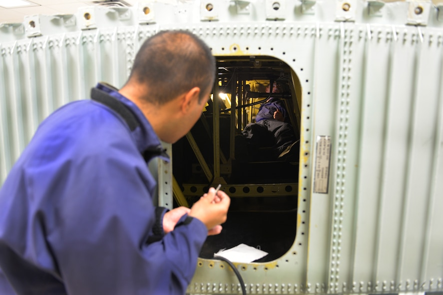 Airman Victor Mendoza 361st Training Squadron aircraft fuel systems apprentice course student learns to diagnose and repair fuel system malfunctions at Sheppard Air Force Base, Texas, July 11, 2017. He supervises are other students remove and replace the No. 2 dump pump in a C-130 wing. (U.S. Air Force photo/Liz H. Colunga)
