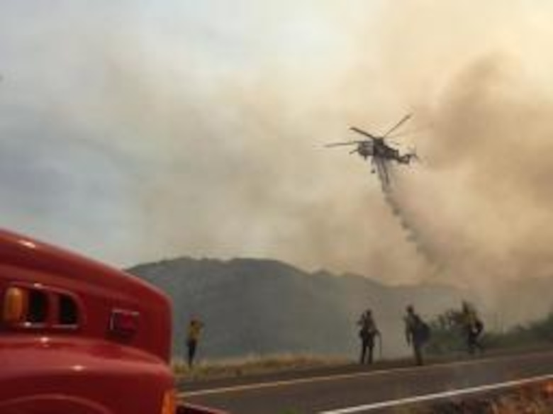 Firefighters from the Arizona Air National Guard's 162nd Wing answered a call for assistance in battling the Frye Fire near Safford, Arizona. On June 20, 2017 the 162nd Wing received an order to activate three citizen-Airmen in support of the Frye Wildland Fire incident management team's aviation section.  The Airmen's training and expertise equipped them to assist the state and community fight the blaze. (U.S. Forest Service photo)