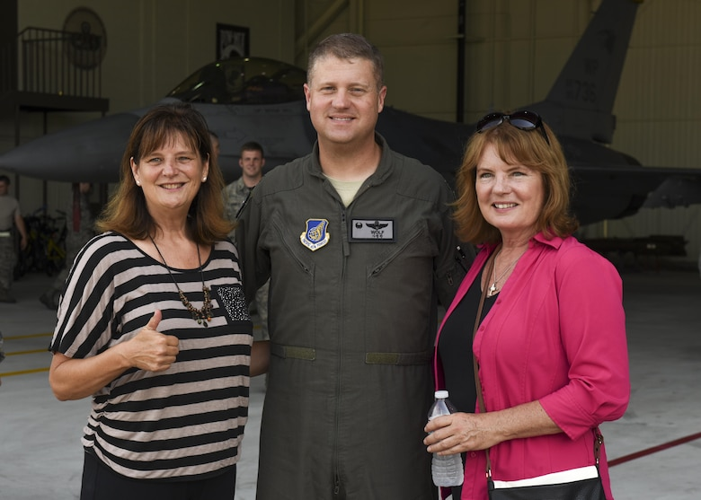Christina Olds, daughter of Brig. Gen. Robin Olds, and Catherine Cook stand with Col. David Shoemaker, 8th Fighter Wing commander, before a weapons load competition at Kunsan Air Base, Republic of Korea, July 14, 2017. The visit commemorated what would have been Robin Olds 95th birthday. (U.S. Air Force photo by Senior Airman Michael Hunsaker/Released)
