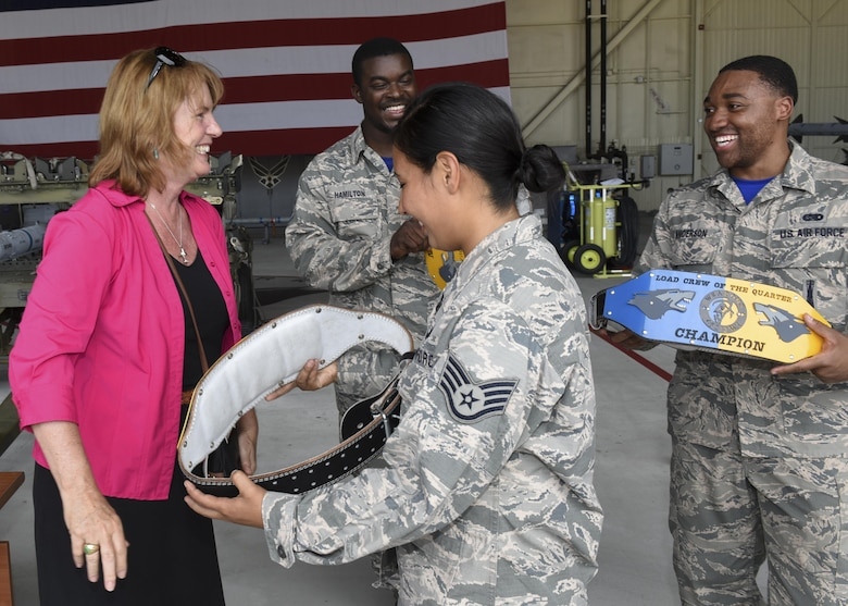 Christina Olds, daughter of Brig. Gen. Robin Olds, presents awards to U.S. Air Force Airmen assigned to the 35th aircraft maintenance unit for winning the quarterly weapons load competition at Kunsan Air Base, Republic of Korea, July 14, 2017. Kunsan held the competition in conjunction with Ms. Olds' visit to commemorate her father, Robin Olds, 95th birthday. (U.S. Air Force photo by Senior Airman Michael Hunsaker/Released)