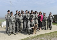 Christina Olds, daughter of Brig. Gen. Robin Olds, stands with members of the 8th Security Forces Squadron during a tour at Kunsan Air Base, Republic of Korea, July 14, 2017. Olds visited Kunsan to celebrate her father's 95th birthday and share his legacy with the Wolf Pack. (U.S. Air Force photo by Senior Airman Michael Hunsaker/Released)