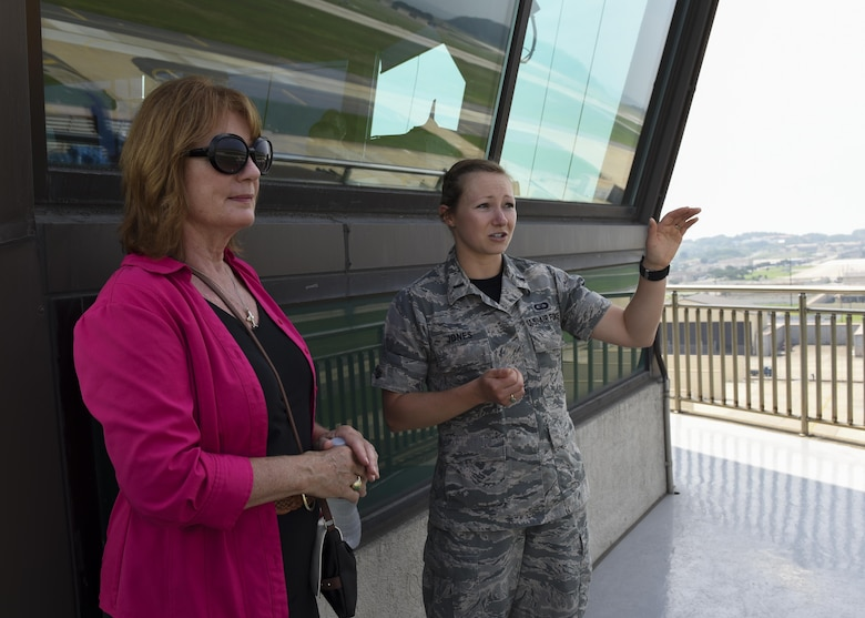 U.S. Air Force 1st Lt. Samantha Jones, 8th Operation Support Squadron airfield operations officer, briefs Christina Olds, daughter of Brig. Gen. Robin Olds, during a tour at Kunsan Air Base, Republic of Korea, July 14, 2017. Olds visited Kunsan as part of a celebration to honor her father's legacy at Kunsan and to celebrate his 95th birthday. (U.S. Air Force photo by Senior Airman Michael Hunsaker/Released)