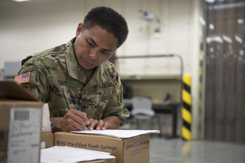 U.S. Army Staff Sgt. Don Kosht, 1-1 Special Forces Group medical logistics technician, reviews an order supplies during a medical material distribution exercise July 13, 2017, at Kadena Air Base, Japan. The order was arranged and requested by the Theater Lead Agent for Medical Material – Pacific. Exercise participants overcame obstacles such as making the most out of transportation and shipment confinements with limited airlift resources and navigating through a myriad of joint-service rules and regulations. (U.S. Air Force photo by Senior Airman John Linzmeier)